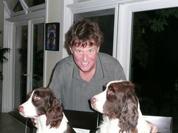 Tom is happy to be back in St. Thomas with the dogs and cats after the NY treatments in 2009.