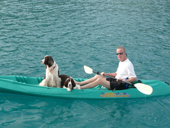 Tom taking dogs to shore for a walk during his birthday cruise - April, 2010.